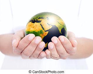 globo, holded, mãos humanas