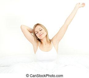 gloeiend, vrouw stretching, terwijl, op het staan