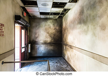 Gloomy burned hall and opened fire exit. Cinema set...