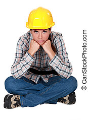 Gloomy female construction worker