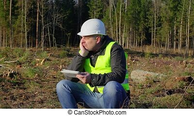 Gloomy forest engineer in forest