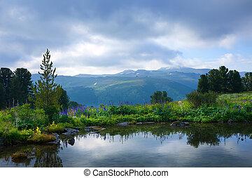 Gloomy landscape of mountain lake. Altai, Suberia
