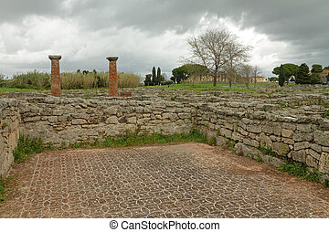 gloomy landscape with ruins of ancient city Paestum, Italy, UNESCO world heritage site