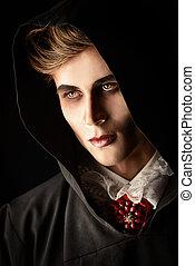 scary vampire - Gloomy, scary vampire in a black cloak ...