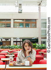 Gloomy student in the cafeteria with food tray - Gloomy ...