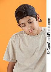 Gloomy Teenager - Bored Native American teenager on orange...