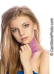 Glorious blonde model with creative makeup posing at studio over a white background