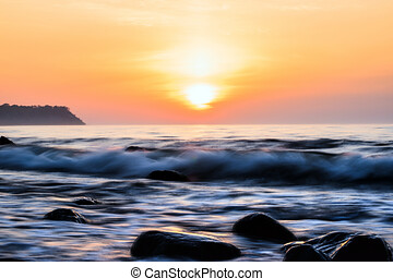 Glorious sunset over the beach bay