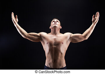 Glory - Image of shirtless man looking upwards with raised...