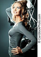 glory time - Beautiful female model posing at studio in the...