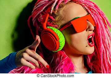 gloss style - Modern party girl DJ in bright clothes,...
