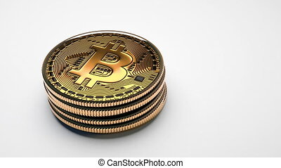Glossy Bitcoin golden coins on white background. Overview footage with copy space in 4k (3840 x 2160 px), 25 FPS.
