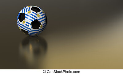 Glossy Uruguay soccer ball on golden metal surface