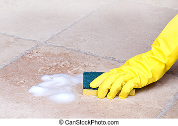 cleaning tile with sponge - gloved hand cleaning tile with ...