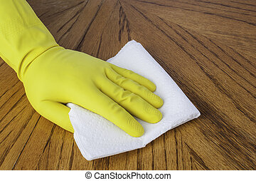 Gloved hand with paper towel