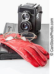 Gloves and glasses - A pair of glasses on a red leather ...