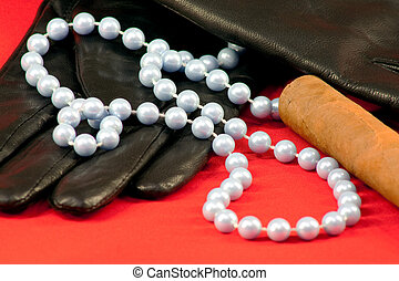 Gloves, beads and a cigar