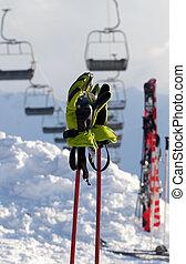 Gloves on ski poles at ski resort