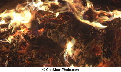 glow and flames close - blazing wood in bonfire