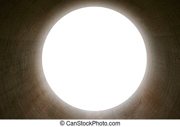 Glow bright light at the end of a round concrete tunnel