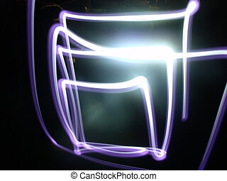 Light traces of an LED forming squares in the dark.