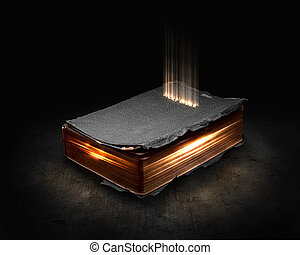 Glowing Bible with light coming from the pages.