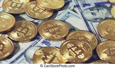 Glowing bitcoins and dollars - Close-up of bright glimmering...