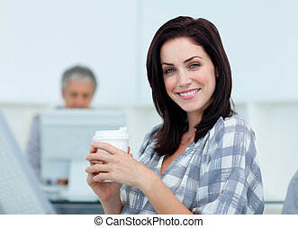 Glowing businesswoman drinking a coffee