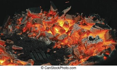 Glowing coals on the grill