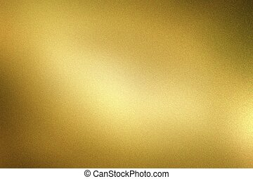 Glowing dark gold foil metal wall with copy space, abstract texture background
