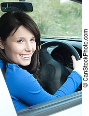 Glowing female teenager sitting in her new car