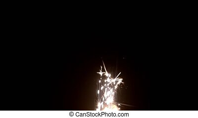 Glowing Flow of Sparks from Firework in the Dark - Magic...