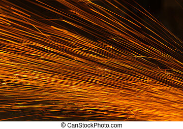 Glowing flow of sparks in the dark, Sparks background