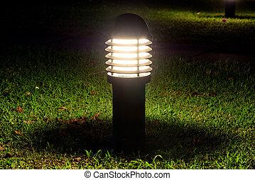 Glowing garden lamp in the dark
