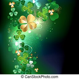 glowing golden shamrock - gold clover with four leaves on a...