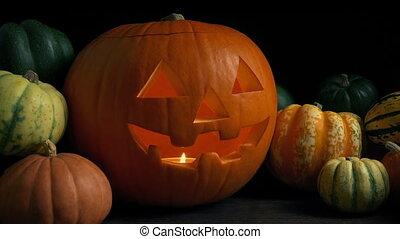 Glowing Halloween Pumpkin On Table