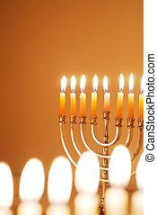 Glowing Hanukkah Candles - Brightly lit Hanukkah menorahs on...