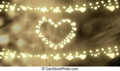 Glowing heart and strings of fairy lights on defocused background
