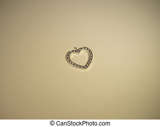 Glowing heart on a cream background