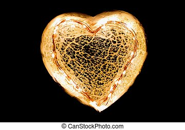 Glowing heart on black background.