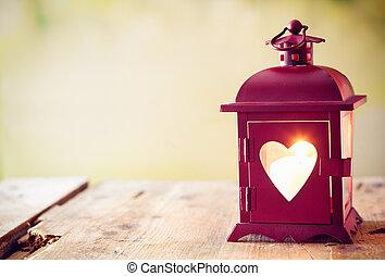 Glowing lantern with a heart - Decorative red metal lantern...