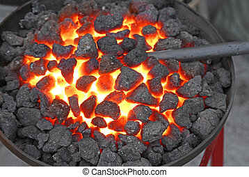 glowing lava in the grate of the blacksmith