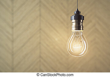 Glowing light bulb on wooden wall background.
