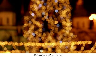 Glowing lights on a christmas tree.