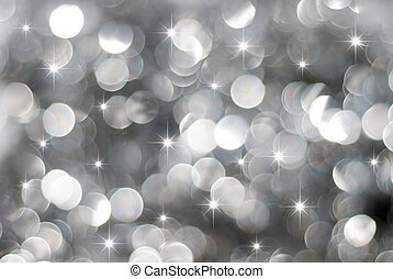 Glowing silver Christmas lights background with little stars