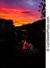 Glowing sunset over the Tiber river in Rome