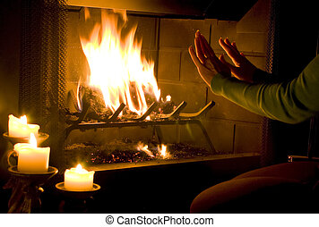 Glowing Warmth - A woman warming her hands by a roaring fire...