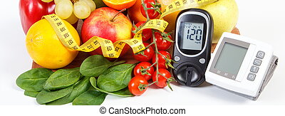 Glucometer, blood pressure monitor, fruits with vegetables and centimeter, healthy lifestyle