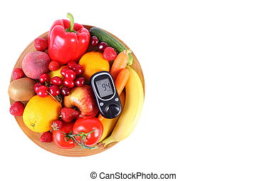Glucometer with fruits and vegetables on wooden plate
