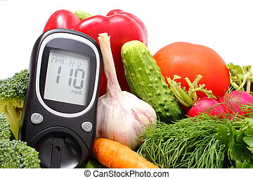 Glucose meter and fresh ripe raw vegetables, desk of healthy organic vegetables, concept for healthy eating and diabetes. Isolated on white background